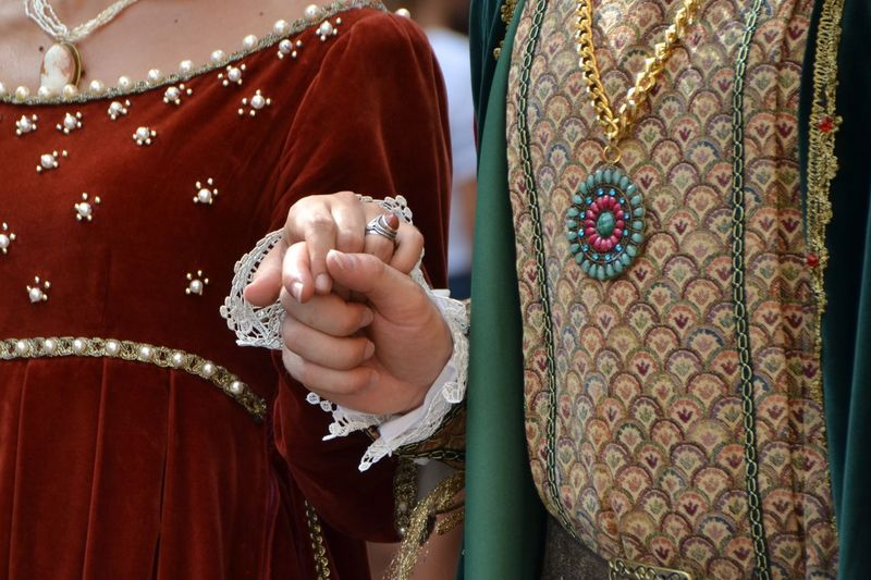 Groom Holding Hands Of Bride During Wedding