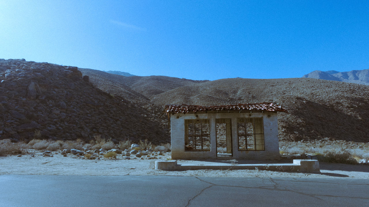 architecture, built structure, sky, mountain, building exterior, clear sky, blue, building, copy space, no people, nature, day, snow, house, cold temperature, winter, entrance, door, landscape, outdoors