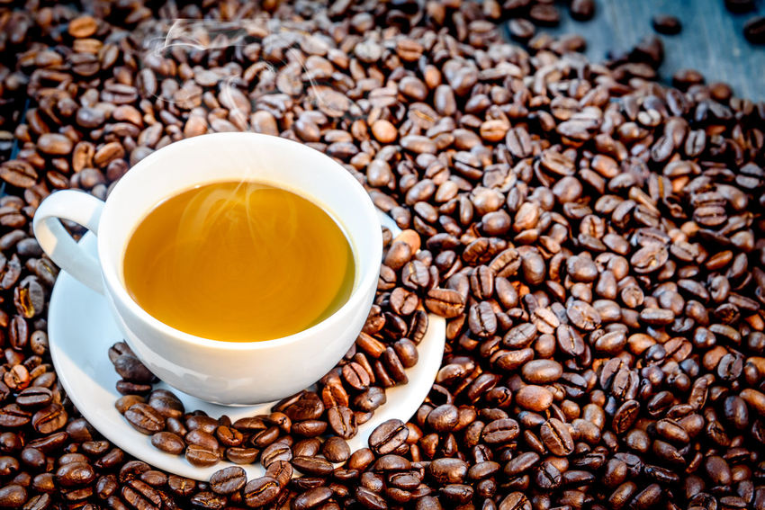 Abundance Close-up Coffee - Drink Coffee Bean Coffee Cup Cup Day Drink Food Food And Drink Freshness Indoors  Large Group Of Objects No People Raw Coffee Bean Refreshment Roasted Roasted Coffee Bean