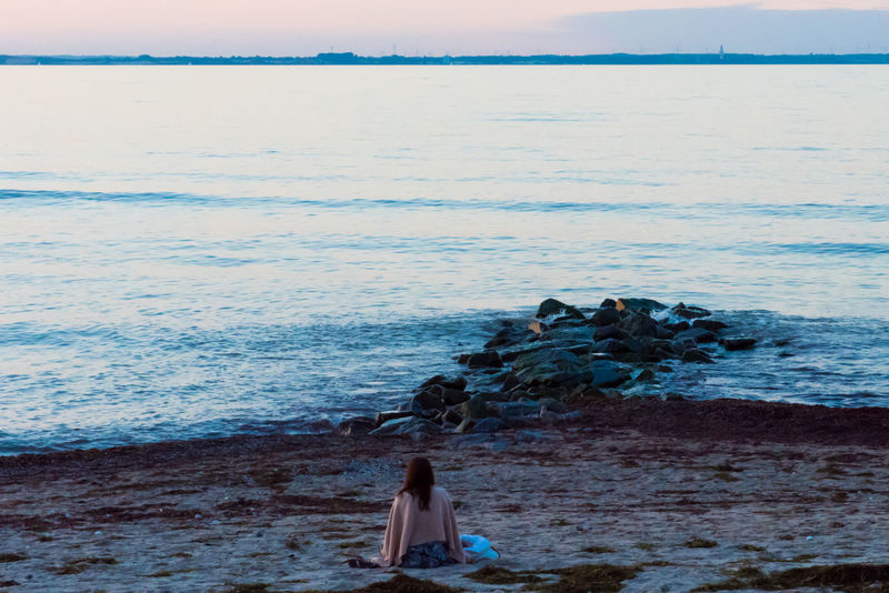 Baltic Sea Sunlight Tranquility Yoga Beach Beauty In Nature Go-west-photography.com Horizon Over Water Horizon Over Water Tranquility Idyllic Nature One Person Outdoors Real People Rock - Object Sand Scenics Sea Sky Sun Sunset Tranquil Scene Water Wave Women