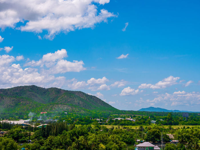 Thai view Sky Cloud - Sky Mountain Scenics - Nature Beauty In Nature Tree Landscape Environment Nature Plant No People Tranquility Day Tranquil Scene Blue Architecture Outdoors Idyllic Green Color Mountain Range TOWNSCAPE