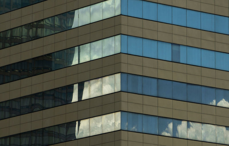 Blue sky reflection on building's windows Architecture Backgrounds Blue Building Building Exterior Built Structure City Day Design Full Frame Glass - Material Low Angle View Modern No People Office Office Building Exterior Outdoors Pattern Reflection Skyscraper Window The Architect - 2018 EyeEm Awards