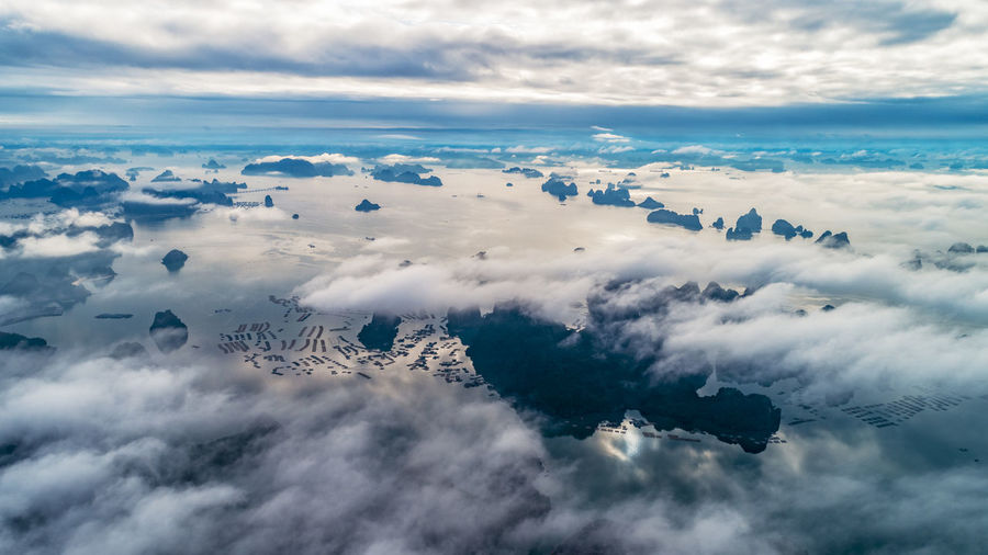 Aerial view of clouds over sea against sky
