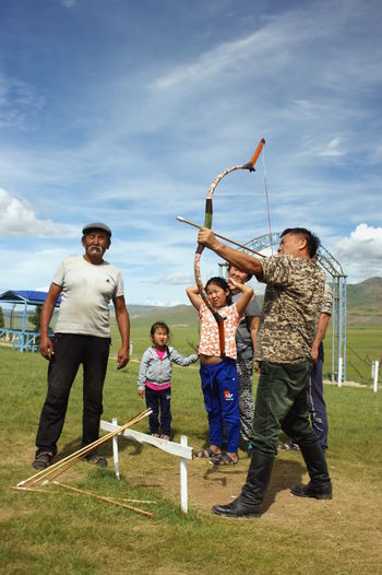 Mongolia Archery Casual Clothing Child Cloud - Sky Day Full Length Group Of People Human Arm Leisure Activity Males  Men Outdoors Real People Sky Steppe Монгол улс