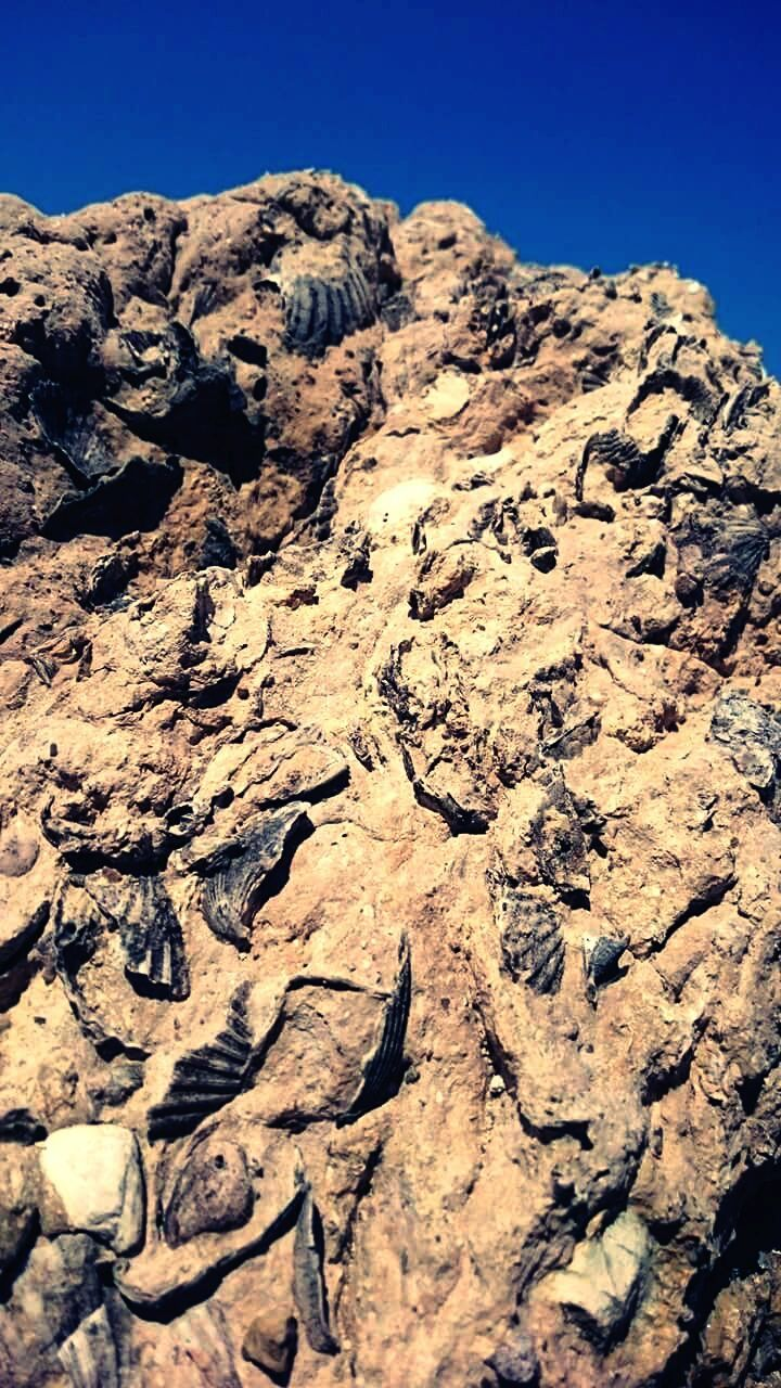 day, outdoors, rock - object, no people, sunlight, nature, clear sky, arid climate, mountain, beauty in nature, close-up, sky