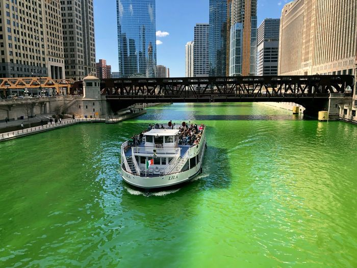 St patrick's day in Chicago Chicago Landscape Landscape_Collection Urban Skyline Urban City Cityscape City Life Boat Travel Travel Destinations Tourism Tourist Attraction  St Patrick's Day Architecture Transportation Nautical Vessel Built Structure Water Building Exterior Mode Of Transportation Bridge Bridge - Man Made Structure Connection Office Building Exterior Waterfront Craft Building Passenger Craft Skyscraper Day Outdoors Modern Financial District  Canal