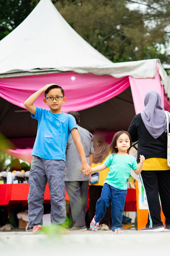Children standing at the event in malaysia.