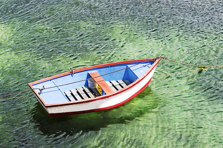 old fisherman boat at sunny day moored in harbor , fishing rowboat Nautical Vessel Tranquility Moored Wooden Hook SurfCasting Rowing Fish Traditional Background Harbor Fishing Sea Pier Port Catch Rowboat Fisherman Boat