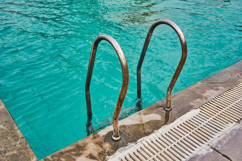 High angle view of swimming pool railing