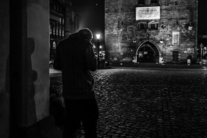 Shadow & the night. [38/365] 2016.11.16 Another day of being busy and so I've only got some time after nightfall. Black & White Black And White Blackandwhite City Men Night One Man Only One Person Outdoors People Real People Rear View Standing Street Street Photography Streetphotography Urban