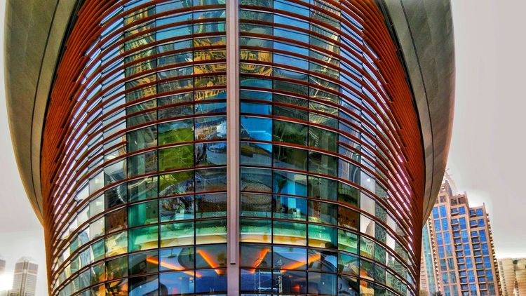Dubai Opera. Architecture Modern Built Structure Building Exterior Office Business Finance And Industry Skyscraper Window Low Angle View No People Day Travel Destinations Multi Colored Outdoors City Business Sky Dubai Operahouse HTC Htc One M8 Awesome City Architecture Reflection