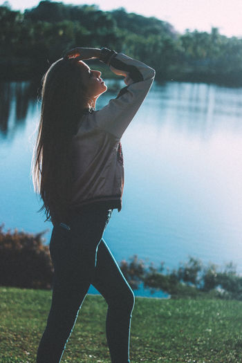 Beautiful Woman Beauty In Nature Casual Clothing Day Focus On Foreground Full Length Lake Leisure Activity Lifestyles Nature One Person Outdoors People Real People Sky Standing Tree Water Women Young Adult Young Women