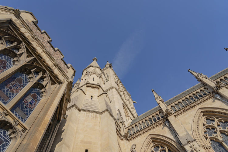 Architecture Low Angle View Building Exterior Sky Religion Building Place Of Worship The Past History Travel Destinations Clear Sky No People Ornate Architectural Column Tall Stone Buildings Cambridge England Tower Church Church Tower Historic Old Buildings Ancient Architecture Historical Building