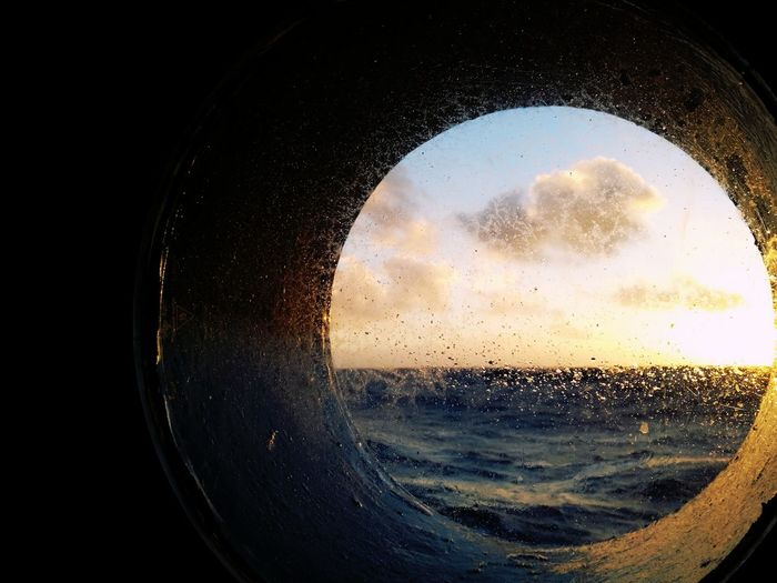 Porthole Sunsets Sea Sea And Sky Seafaring Ocean Open Ocean Clouds And Sky Water And Sky Sub Antarctics Open Sea At Sea Porthole Sunset Close-up No People Drop Water Day