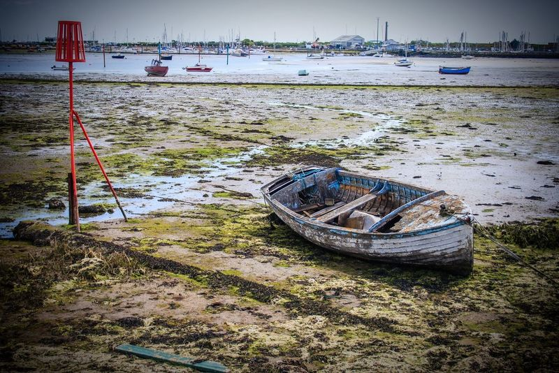 An Old Battered Boat Resting on the Harbour floor. HDR Boat Boats Harbour Sea Decay Langstone Harbour  Hampshire