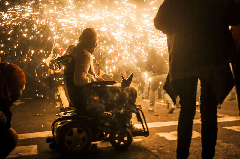 Correfocs (fireworks) of the major summer festival of Barcelona City Action Shot  Alepho Backlighting Barcelonacity Correfocs Crowd Disabled Enjoying Life Enjoyment Festival Fireworks Having Fun Into The Action Leisure Activity Lifestyles Light Lowlight Night Photography Playing With Fire Playing With Fireworks Real People Sony Alpha Summertime Urbanphotography Wheelchair