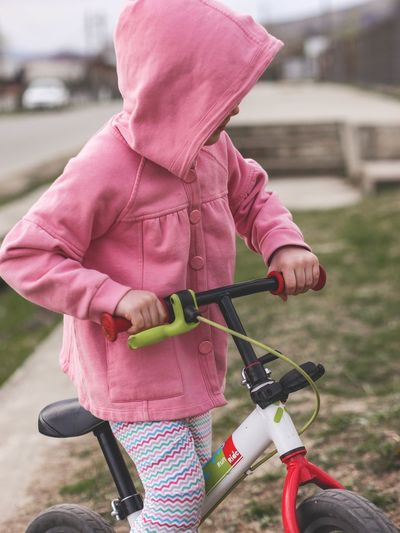 Rear view of woman riding bicycle
