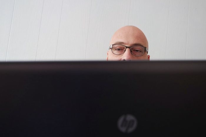 Working from home Concentration Reading Glasses Programming Laptop Using Laptop On Line Focused Minimalistic Typing Developer Technology Man At Work Half Face Internet Addiction