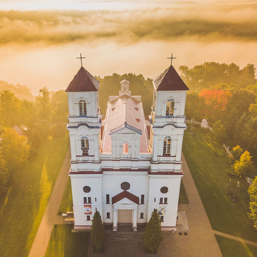 Church against sky during sunset