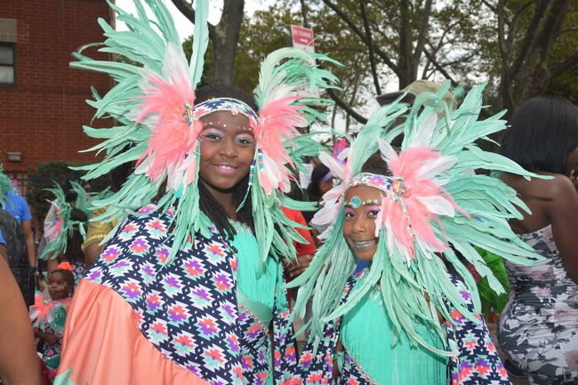WIADCA-Annual Kiddie Carnival Brooklyn Carnival Carnival Headdress Carribean Cultures Feather Headdress Feathers Kiddies Carnival Parade Tradition Traditional Clothing Vibrant Color Westindiancarnival Westindianspeople WIADCA Young Adult