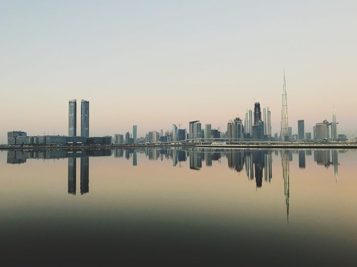 Dubai reflecting on the water canal of Ras Al Khor, United Arab Emirates 🇦🇪 Reflection Mirror Dubai Sunrise Urban Panorama Panoramic Architecture Reflection Building Exterior Skyscraper Built Structure City Water Waterfront Clear Sky Cityscape No People Sky Urban Skyline Travel Destinations Modern Symmetry Outdoors