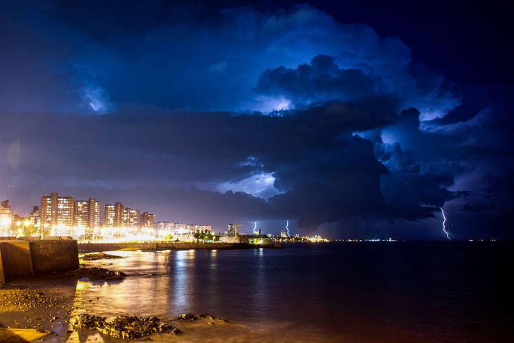 Night Cloud - Sky Illuminated No People Travel Destinations Architecture Outdoors Landscape City Cityscape Beauty Water Sky Sea Blue Nature Nautical Vessel Urban Skyline Thunderstorm Lightning