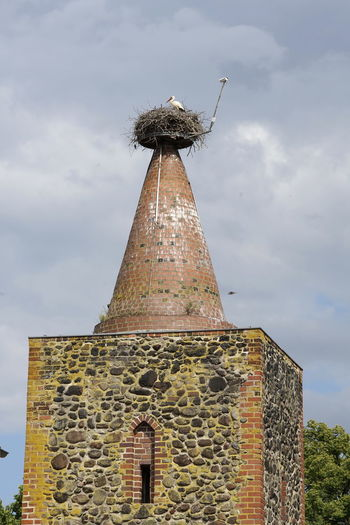 Architecture Bird Breeding Building Exterior Built Structure Cloud - Sky Day Historical Building Low Angle View Nature Nest Nesting Birds No People Outdoors Sky Storchenturm Stork Nest Tower