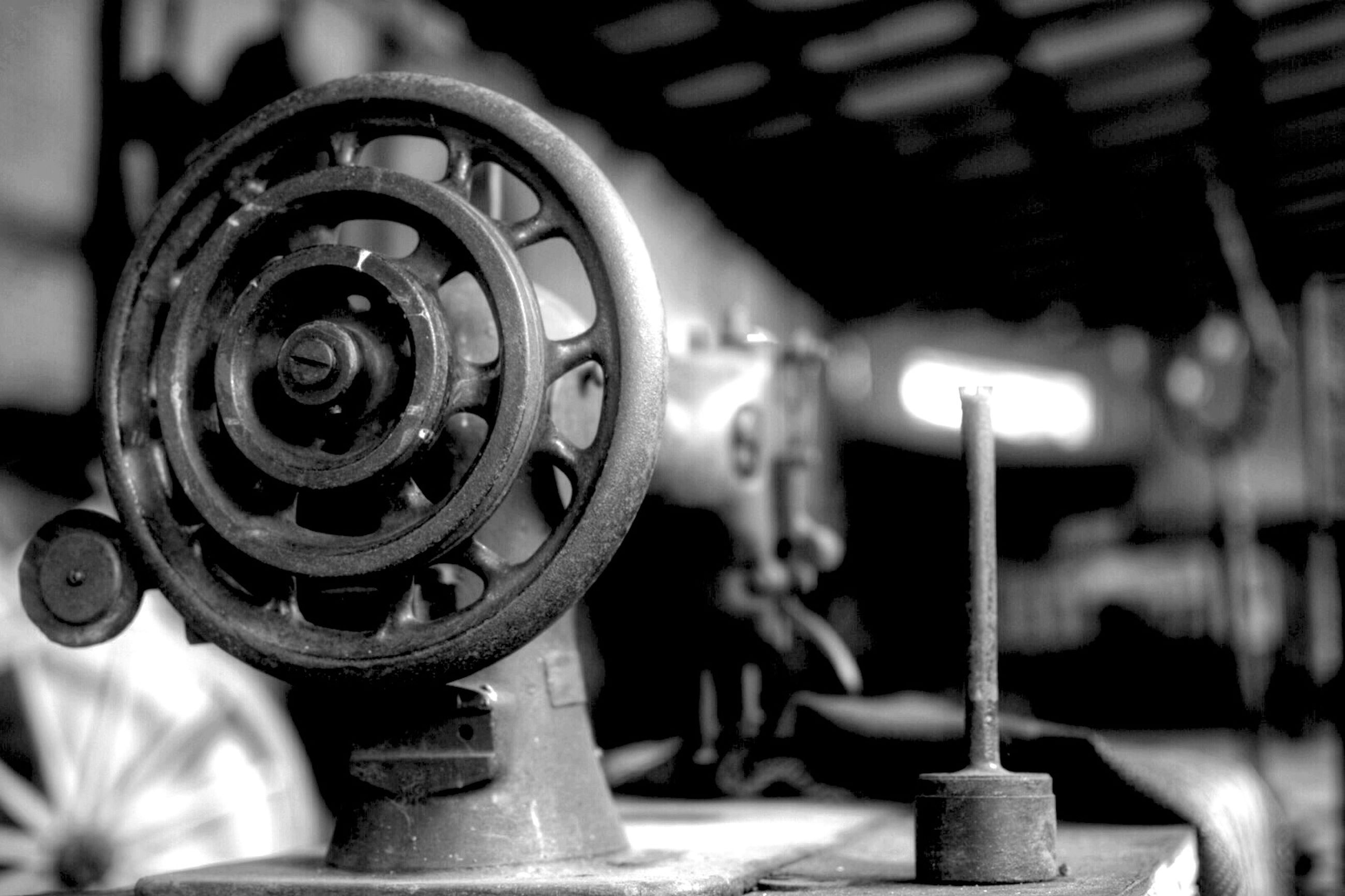 metal, focus on foreground, close-up, indoors, machine part, technology, machinery, metallic, selective focus, old-fashioned, equipment, part of, industry, retro styled, old, no people, day, transportation, man made object, music