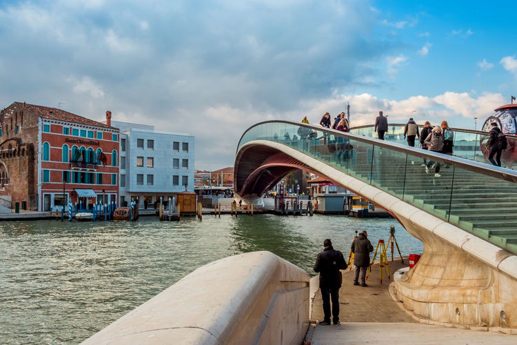 Pedestrian bridge of the Constitution leading to the Piazzale Roma in Venice Italy. Architecture Built Structure Water Cloud - Sky Men Building Exterior Sky Group Of People City Real People Bridge People Transportation Connection Nature Bridge - Man Made Structure Lifestyles Leisure Activity Women Outdoors Venice, Italy Constitution Perspective Editorial Photography EyeEm Best Shots