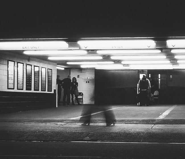 Ghost Walker Illuminated People Blackandwhite Photography Olympus Monochrome City Life Manhattan Nusevoice Everybodystreet NYC Street Photography Real People Longexposureoftheday Outdoors Arts Culture And Entertainment Lifestyle Parkinggarage Welcome To Black
