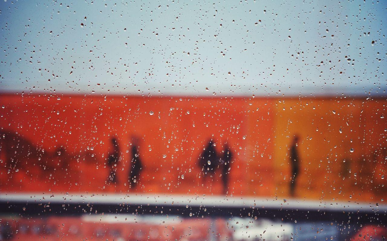Aros aarhus kunstmuseum seen through wet glass window