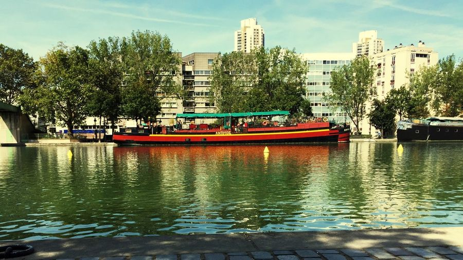 Transportation Nautical Vessel Water Mode Of Transport Tree Built Structure Architecture City Building Exterior Paris Boat River Sky Day Nature No People