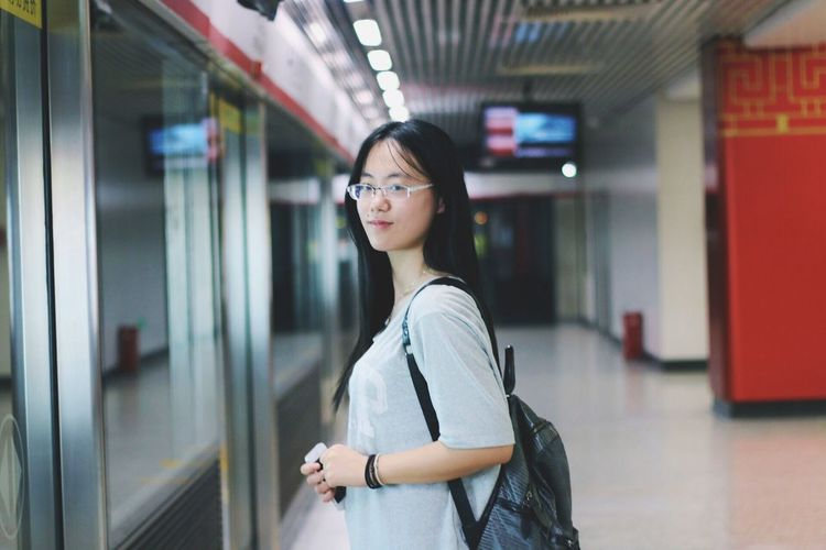 Side view of woman in eyeglasses standing in nanjing university of science and technology