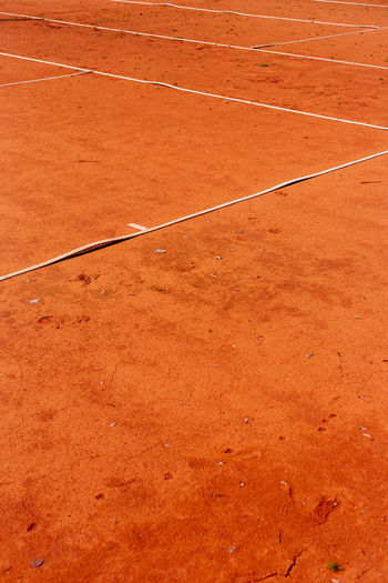 High Angle View Of Lines On Orange Dirt At Playing Field