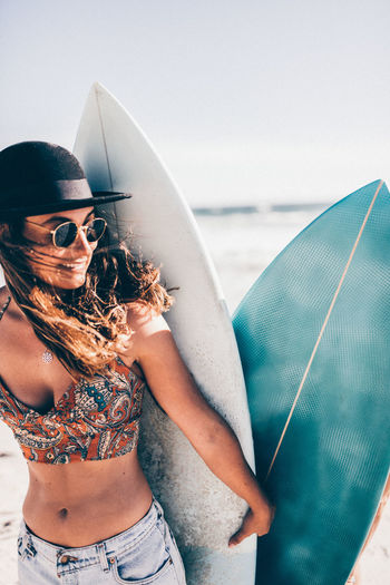 Sunglasses Fashion Glasses Young Adult Real People One Person Lifestyles Leisure Activity Young Women Adult Women Casual Clothing Sea Day Water Nature Beautiful Woman Outdoors Surfboard Surfing