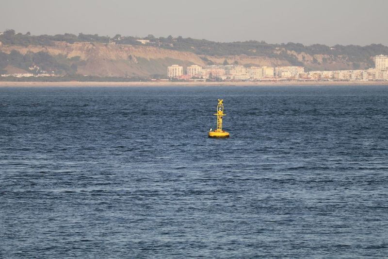 Buoy floating at tagus river
