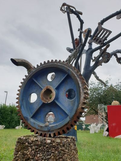 Close-up of machine part on field