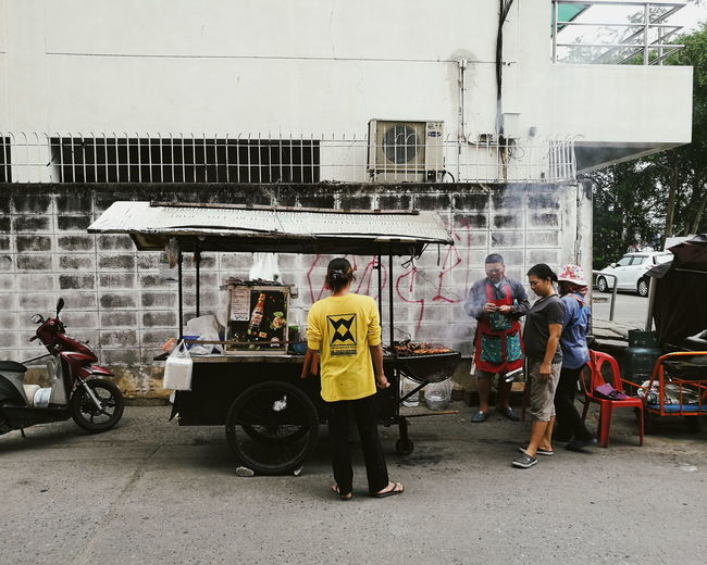 street food Streetphotography Street Food Built Structure Day Outdoors People Men Full Length Motorcycle Car Wash Architecture Sky Built Structure