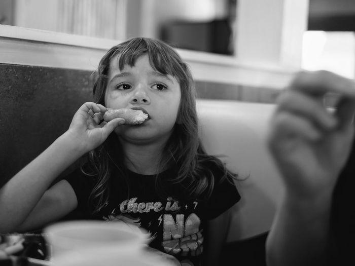 Girl eating food at home