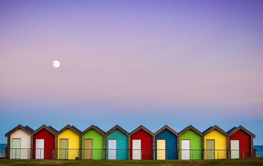 Blyth beach huts at moon rise Coast Moon Coast In A Row Colourful Multi Colored Beach Huts Beach Beach Huts Northumberland Coastline Northumberland Blyth
