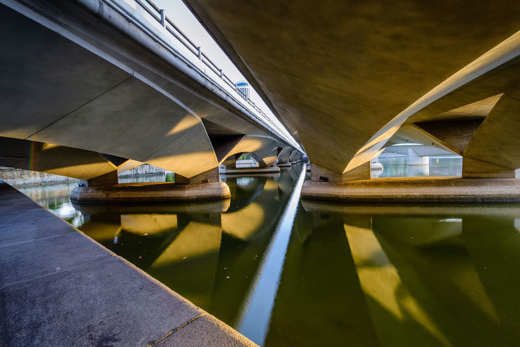 Low angle view of bridge over canal in building