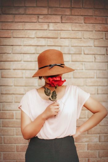 Hiding inside myseLf. Standing Brick Clothing One Person Hat Front View Wall Brick Wall Obscured Face Wall - Building Feature Adult Casual Clothing Fashion Waist Up Holding Unrecognizable Person Facial Hair Portrait