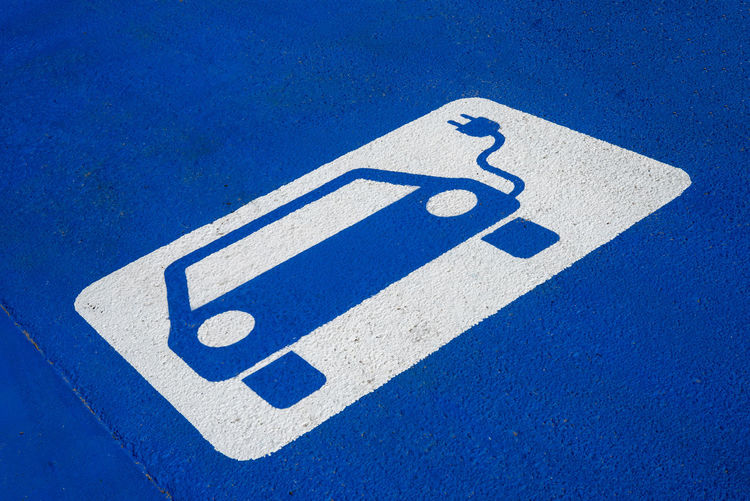 Close-up of electric vehicle charging station sign