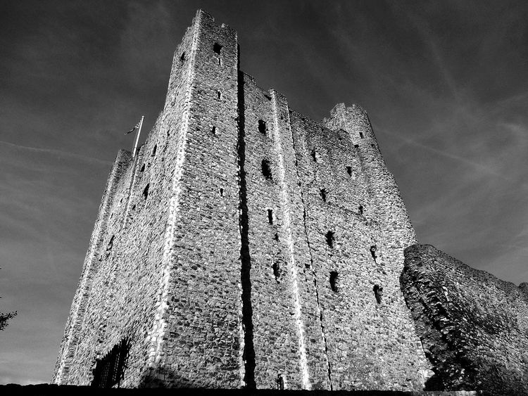 Monochrome Photography Architecture Built Structure Building Exterior Low Angle View Tower Tall - High Sky Tall Outdoors Vapor Trail History Day Sunbeam Gothic Style Place Of Worship Architectural Feature Tourism Medieval Cloud - Sky Modern Art Gallery Today's Hot Look Bestoftheday Rochester Castle