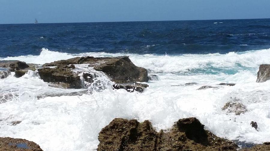 Sea Spray Blue Sky Blue Water Breaking Waves Ocean Rocks Sky Water Over Rocks