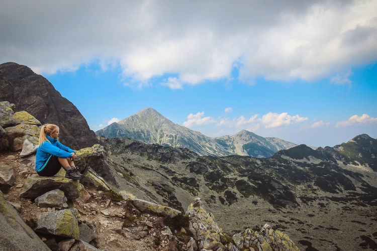 Retezat mountains Adventure Backpack Beauty In Nature Blond Hair Boys Casual Clothing Childhood Climbing Cloud - Sky Day Full Length Hiking Leisure Activity Lifestyles Mountain Mountain Range Nature One Person Outdoors Real People Rock - Object Scenics Sitting Sky Standing Go Higher