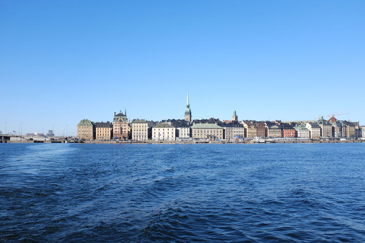 Buildings in distance with waterfront