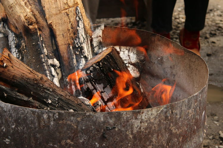 Wood burning in rusty fire pit