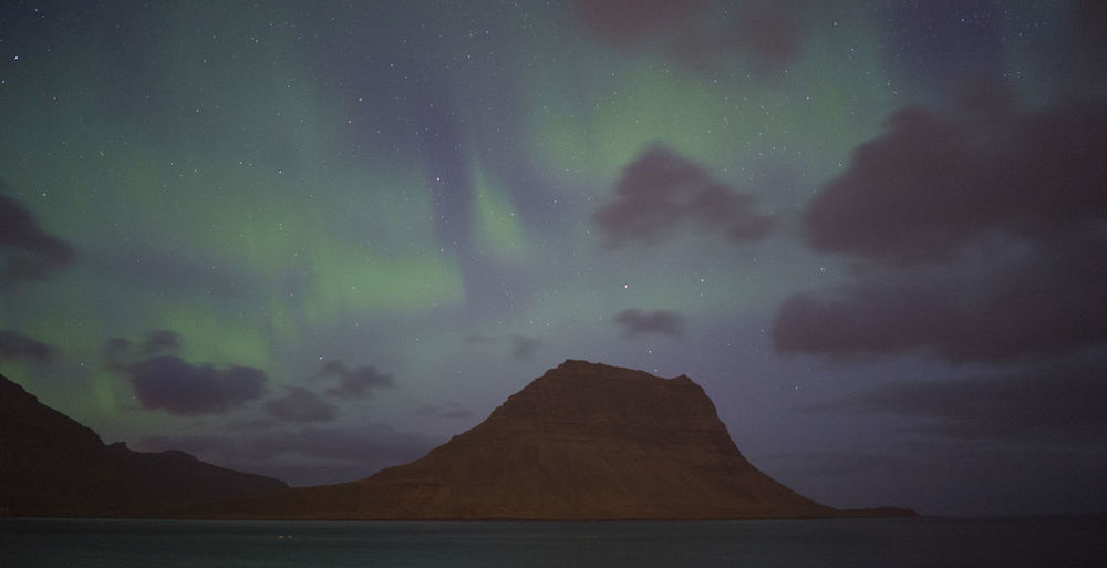 Astronomy Aurora Borealis Clouds Dark Iceland Infinity Kirkjufell Mountain Night No People Northen Lights Outdoors Sea Star Stars Landscapes With WhiteWall The Great Outdoors With Adobe The Great Outdoors - 2016 EyeEm Awards