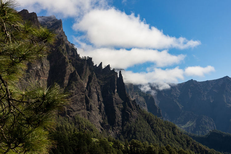 Caldera de Taburiente, La Palma Caldera La Palma, Canarias Beauty In Nature Caldera De Taburiente Caldera View Clouds Clouds And Sky La Palma Landscape Mountain Mountain Peak Mountains Mountains And Sky No People Rock Scenics - Nature Tranquil Scene Tree